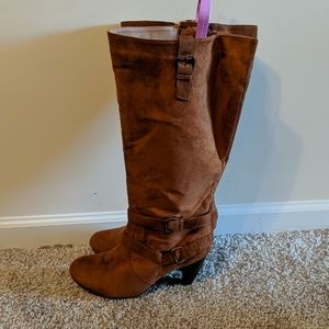 Brown heeled knee high boots